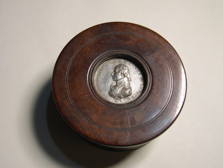 A Mahogany Box, the lid inset with metal memorial medal of Horatio Nelson, 1st Viscount Nelson ...