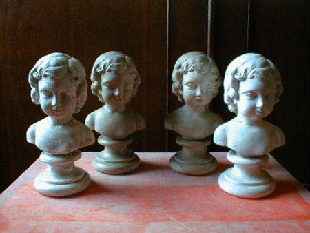 Seven busts of two children