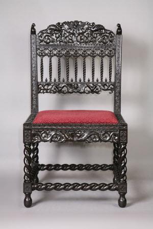 A set of six ebony chairs