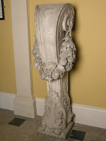 Chimneypiece scrolling pedestal carved with acanthus leaves and anthemion and hung with vine in ...