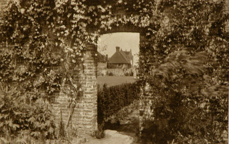 South Cottage, Sissinghurst, Kent, seen through the archway.