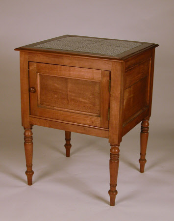 A pair of cherry and oak bedside cupboards, probably French, circa 1900-1950
