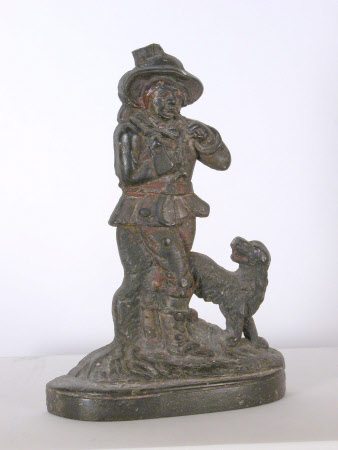 Doorstop of medieval piper with dog
