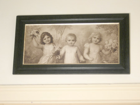 Three children with flowers