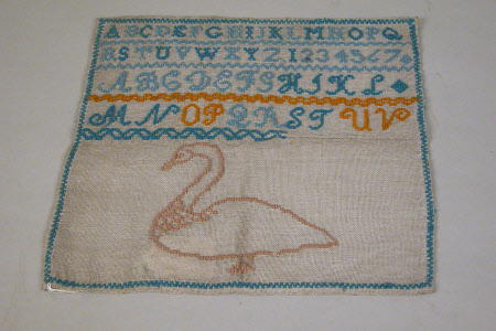 Sampler, Alphabets, Numerals and a Swan