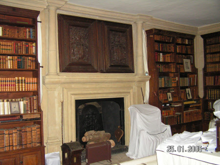 Chimneypiece with Georgian bolection moulding around grate and pilasters each side on lower stage, ...