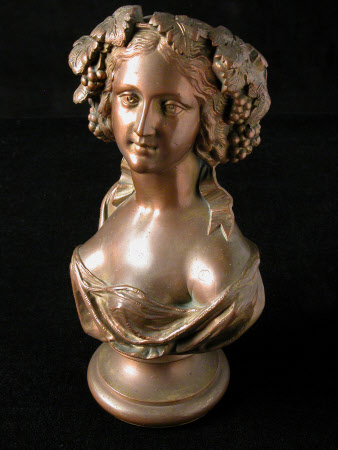 Bust of a bacchanalian lady with a grape and vine leaf wreath on her head