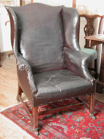 Wing-back armchair
