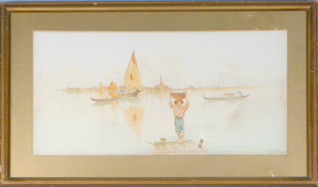 A boy carrying a basket on his head, with sailing boats and a gondola in the lagoon with Venice ...