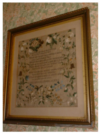 Sampler, A Verse with a Floral Border