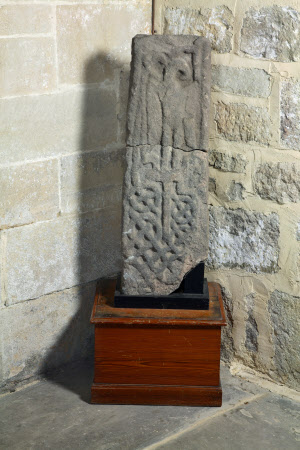 Part of a Anglo-Saxon stone cross with interlace pattern and eagle design