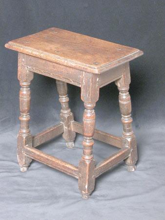 A pair of oak joined stools, English, circa 1640
