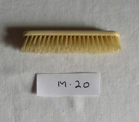 Doll's clothes brush