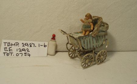 Bisque doll in pram