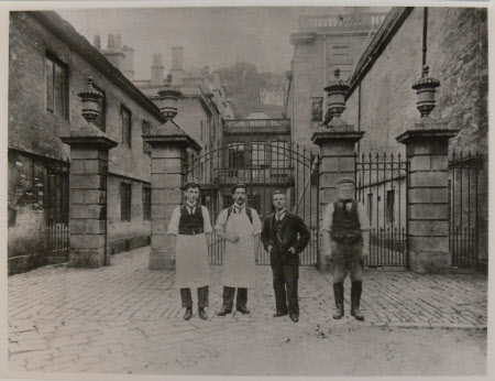 Staff outside stableyard, Dyrham Park, Gloucestershire: Left to right Wallace Rumney apprentice ...