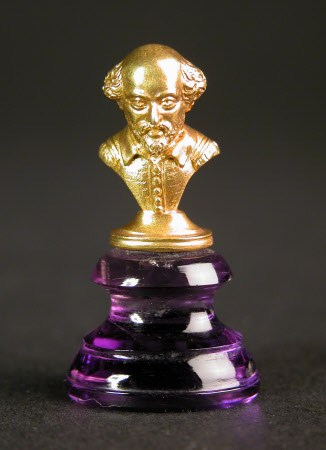 Purple glass seal, the handle in the form of a gold bust of William Shakespeare (1564-1616)