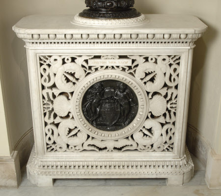An openwork Lorandini stove in Carrara marble, its centre inset with a Marochetti bronze medallion ...