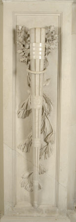 One of a pair of Torcheres carved from Biancone Marble from Bassano draped with fir and holly