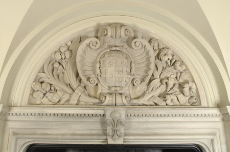 Stone carvings around and over the chimney-piece with the coat of arms of William Bankes (sable, a ...
