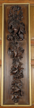 One of a Pair of Stained Limewood Panels carved with Dead Birds and Fruit