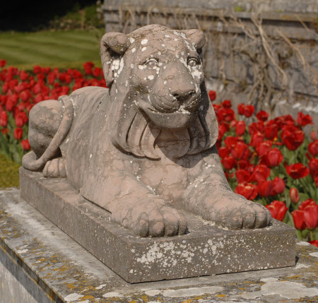One of a Pair of Rosso Veronese Recumbent Lions.
