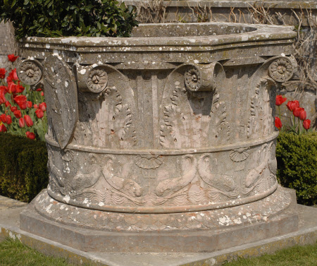 Well-head carved in the form of a Vapital, in Verona red Marble, with Acanthus Leaves and a Rampant ...