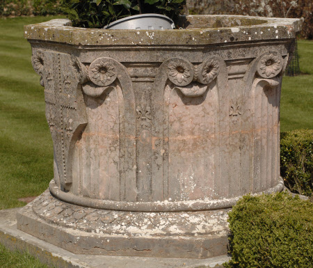 Well-head carved in red Marble in the form of a Capital, with fluted Decoration and Shields with ...