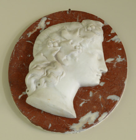 One of a Pair of White Roundel Marble Reliefs of Classical Heads on a red Marble background: ...