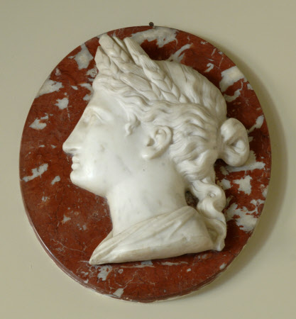 One of a Pair of White Roundel Marble Reliefs of Classical Heads on a red Marble background: Ceres: ...