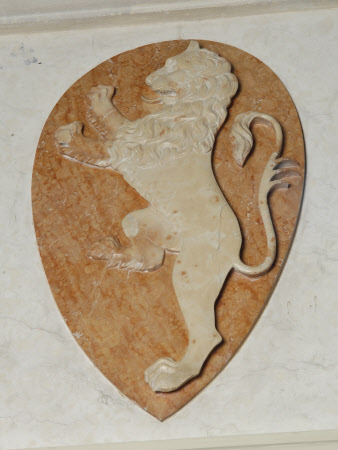 One of a Pair of white Marble Rampant Lion Reliefs on red Marble ground