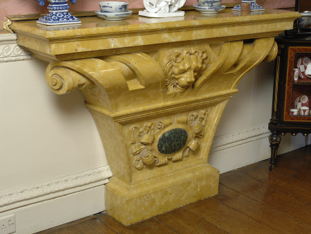 One of a pair of marble console tables carved with scrolling and lion's heads, green marble oval ...