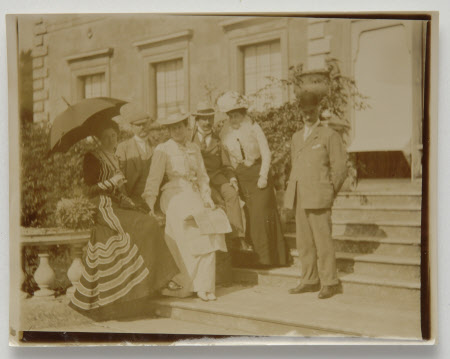 Group including Henrietta Jenny Fraser, Mrs Walter Ralph Bankes (1871-1953) on steps of south ...