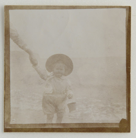 Viola Florence Geraldine Bankes, later Mrs Norman Bruce Hall (b.1900) with bucket, paddling at ...