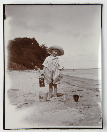 Henry John Ralph Bankes (1902-1981) on Studland beach, Dorset, with watering can, c.1905.