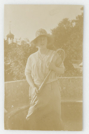 Daphne Maud Adelaide Bankes (1898-1967), holding a tennis racket on stone seat south terrace, ...