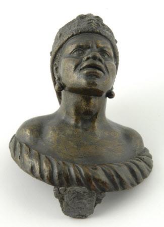 Door knob in the form of an African Head