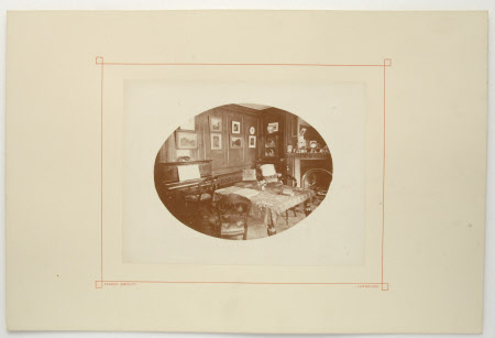 View of a sitting room with piano, possibly lodgings whilst at Trinity College of Walter Ralph ...