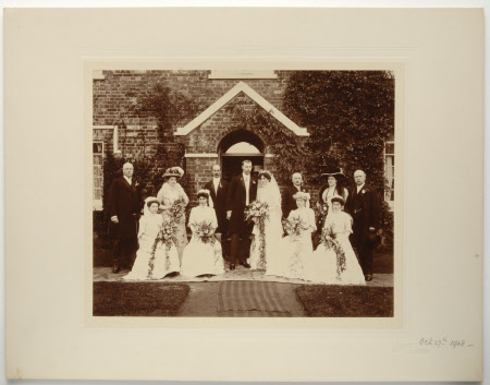 A wedding party at Hillbutts, with Thomas Lodder standing to the right of the bride