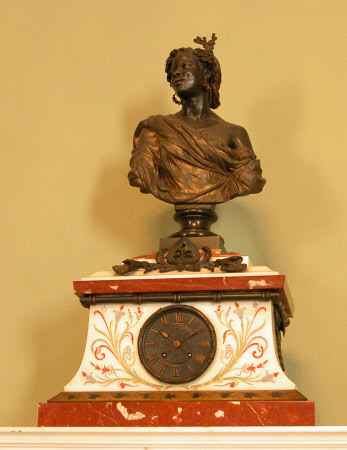 Bust of a Negress (surmounted on a marble base with clock)