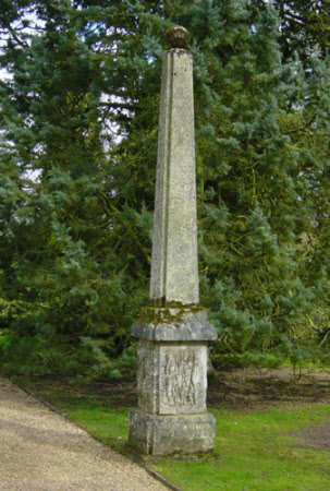 Pair of Obelisks, each surmounted by a ball finial, on square bases carved with stalactites.