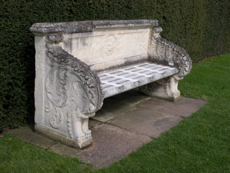 Carved Stone Seat with Acanthus decoration and a central Medallion of a Lion's Head