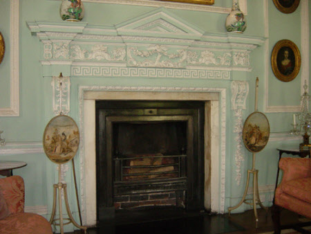 Chimneypiece, Rococo style, with plaster moulding of eagle and foliage design and Greek key frieze ...