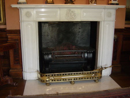 Chimneypiece, with central putti scene and two floral roundels, Library, Melford Hall, Suffolk.