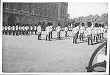 Guards on parade, outside Buckingham Palace, London
