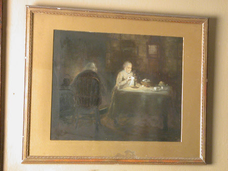 An old lady and old man seated in a candle-lit room