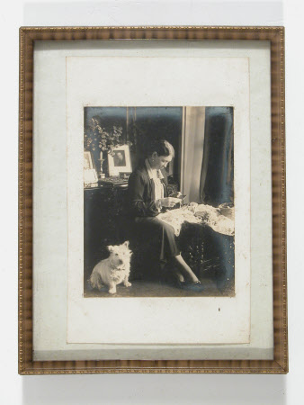 Portrait of unidentified woman with dog