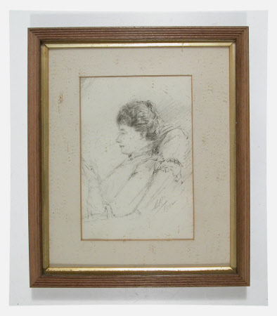 Woman seated, reading