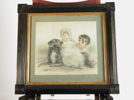 Two children and a dog, members of the Acland family