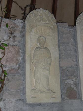 Male saint holding book, set into a niche.