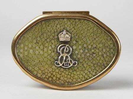 An oval tortoiseshell snuff box with shagreen lid set with a cypher of King Edward VII (1841-1910) ...